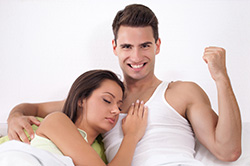 Satisfied Man Yes Fist in Bed with Woman